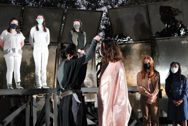 """Hamlet (Madi Sipe) removes the crown of Queen Gertrude (Zoe Beasley) as others - from left, Rosencrtantz (Alexandra Shewmaker, Guilderstern (Karissa Ward), Osrice (Hope Fambrough) and two attendants (Elijah Hauger and Malia Williams) - watch in Abilene High's production of """"Hamlet,"""" which will be performed outdoors at the Rose Park amphitheater."""