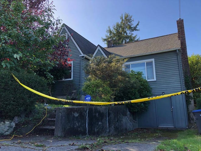 A home on High Avenue where police found the bodies of a man and a woman on Monday morning.