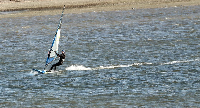 A windsurfer takes advantage of the breeze off of Silverdale Waterfront Park on Monday, October 13, 2020.