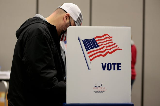 Voters fill out early ballots at the Boone County Extension Enrichment Center in Burlington, Ky., on Tuesday, Oct. 13, 2020. The poll place at the center opened at 9:00 A.M. for early voting in the 2020 election.
