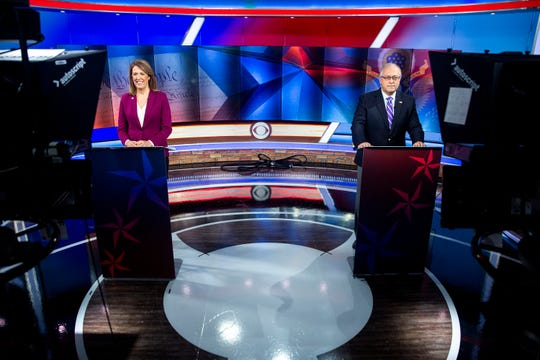 U.S. Rep. CindyAxne, D-Iowa, and Republican challenger, Former U.S. Representative for Iowa's Third District David Young, participate in a debate on Monday, Oct. 12, 2020, at the KCCI studio in Des Moines.