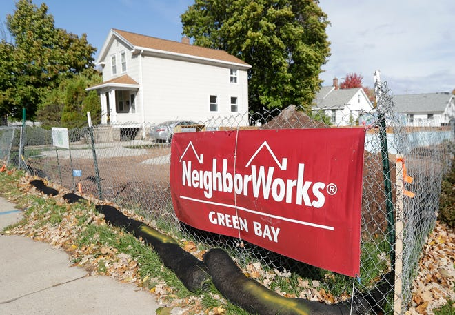 A NeighborWorks sign in front of a residential construction project on Shawano Avenue in Green Bay.