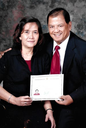 Delmario Cortez and his wife, Teresita Cortez, with his U.S. Certificate of Naturalization. Delmario Cortez was the 59th person on Guam to die from COVID-19.