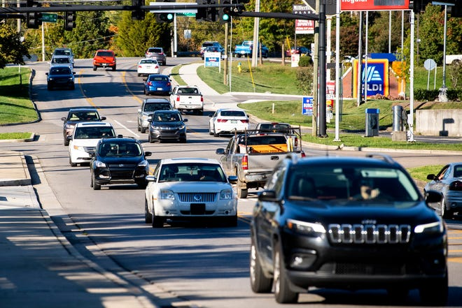 Cars drive through the Loves Creek intersection on Millertown Pike during evening rush hour in Knoxville on Tuesday, October 13, 2020.