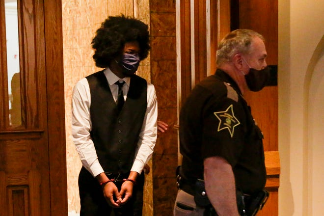 Andre Hastings is escorted into the Tippecanoe County Courthouse by Sheriff's deputies, Tuesday, Oct. 13, 2020 in Lafayette. Hastings is charged with murder and attempted murder in connection of Aug. 2019 killing of Drequan Burglar at Romney Meadows Apartments.