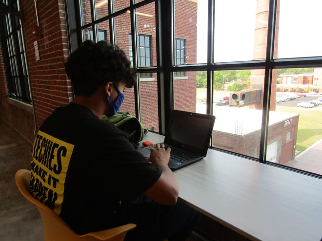 A Purdue Polytechnic High School Englewood student finds a quiet spot for study at the school in Indianapolis. Purdue recently named the school the Schweitzer Center at Purdue Polytechnic High School Englewood after the Edmund and Beatriz Schweitzer gave $4 million for scholarships and other help for students coming to Purdue.