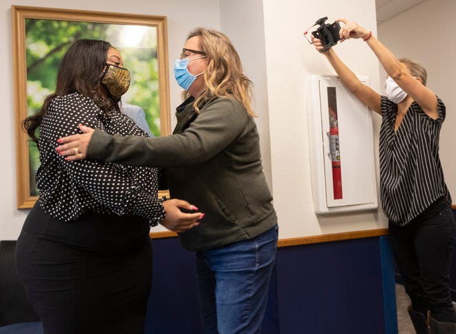 Unique Edwards, left, and Kris Klug meet for the first time Tuesday, October 13, 2020 at Versiti Blood Center of Wisconsin in Milwaukee, Wis. Edwards, who was critically ill with COVID-19, credits her recovery to the antibodies in the plasma she received from former COVID patient Klug. Edwards also works at the blood center.