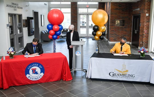 Louisiana Tech University President Les Guice , far left, and Grambling State University President Rick Gallot, far right, signed an agreement Tuesday that allows some GSU students to start taking graduate-level accounting courses at Tech while they are still earning undergrad credits.