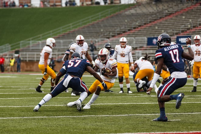 Wide receiver Jonathan Hodoh (18) attempts to elude a Liberty tackler after making a reception in ULM's 41-7 loss to the Flames last Saturday.