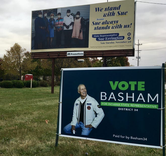 State Rep. Sue Errington, D-Muncie, challenged by Republican Dale Basham, is pictured wearing a mask alongside masked supporters on a billboard, near the Cardinal Greenway Depot.
