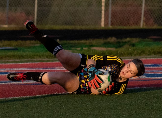 Licking Valley goalie Erin Selfe makes a diving save in a recent Licking County League game against Watkins Memorial.