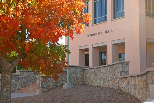 Leaves change colors outside of O'Donnell Hall as fall arrives on the New Mexico State University campus in November 2015.