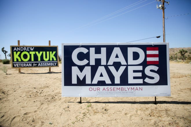 Campaign signs for Andrew Kotyuk and Chad Mayes for the 42nd Assembly District sit near Highway 62 in Yucca Valley, Calif. on Tuesday, October 13, 2020.