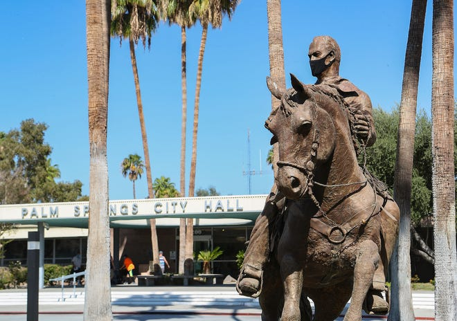 The statue of former Palm Springs mayor Frank Bogert wears a mask outside of Palm Springs City Hall, October 13, 2020.