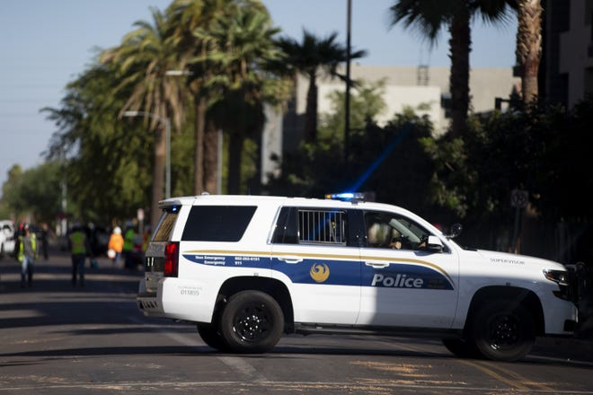 Phoenix police and SWAT team members work a crime scene near Fifth and Portland streets on Oct. 13, 2020.