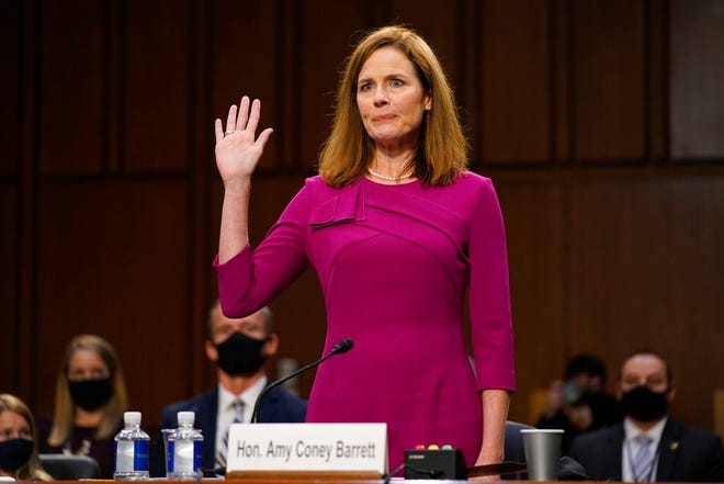 Supreme Court nominee Amy Coney Barrett is sworn in during a confirmation hearing before the Senate Judiciary Committee, Monday, Oct. 12, 2020, on Capitol Hill in Washington. (AP Photo/Patrick Semansky, Pool)