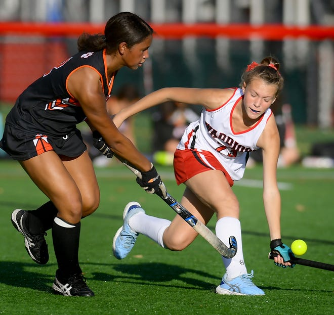 Susquehannock's Natalie Badour defends Central York's Victoria Whitehead during field hockey action at Susquehannock Tuesday, Oct. 13, 2020. Central went on to win 2-1. Bill Kalina photo