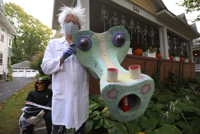 Ward Hartenstein, dressed as Dr. Spectre, will use a homemade musical instrument to deliver Halloween candy to trick or treaters.