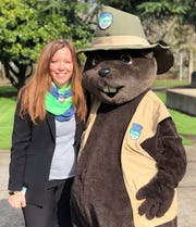 Lisa Sumption, director of the Oregon Parks and Recreation Department, stands with J.R. Beaver, mascot for the Junior Ranger Program.