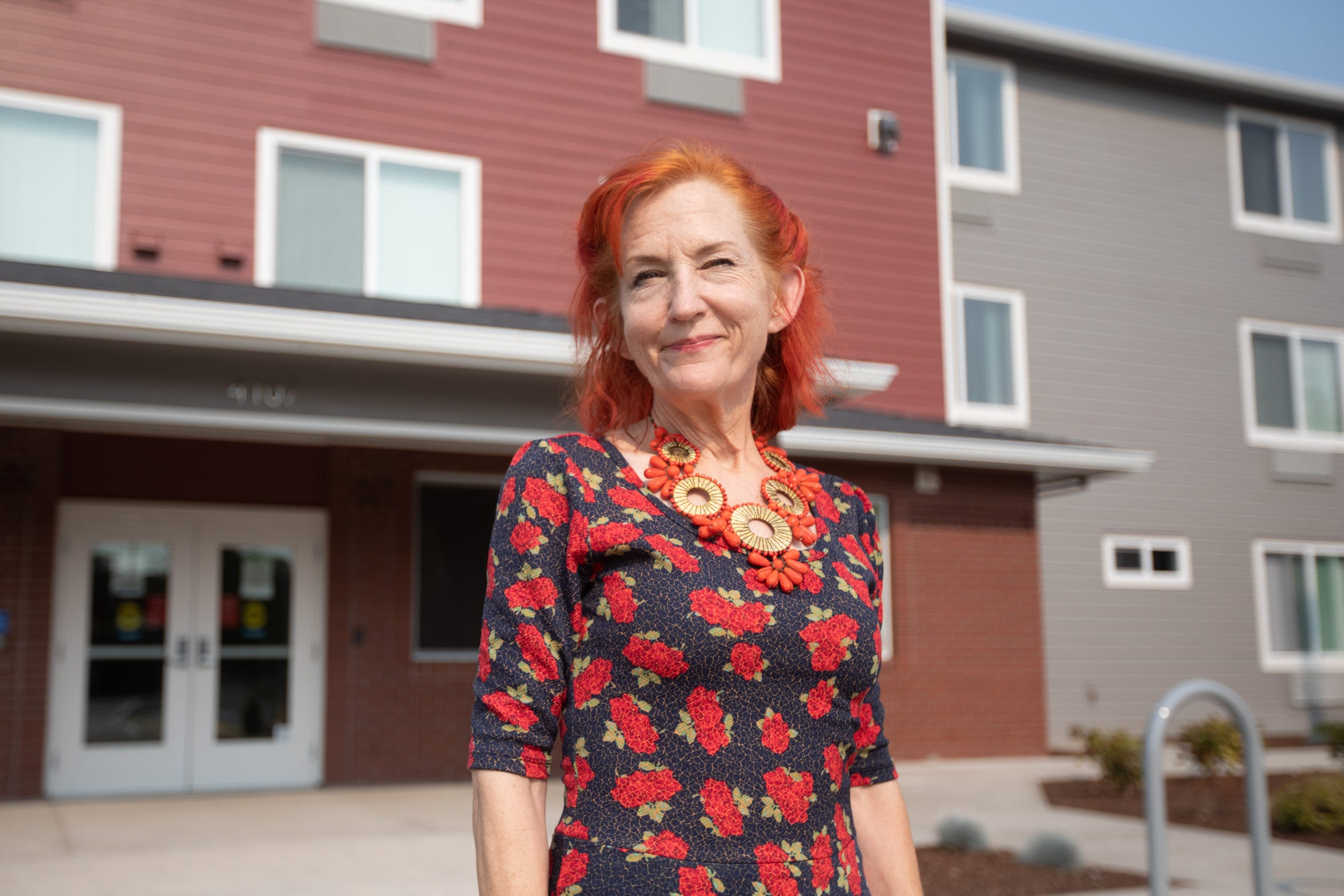 Glenda stands outside the Salem Health Authority's Redwood Crossings supportive housing development.
