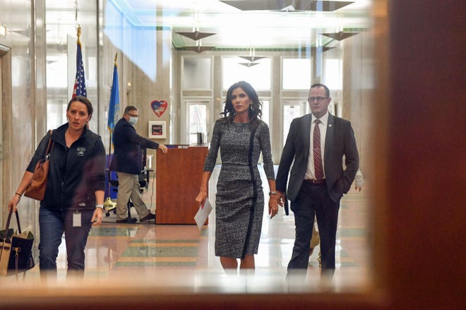 Gov. Kristi Noem and  Public Safety Secretary Craig Price walk together on their way to a press conference Tuesday, Oct. 13, at City Hall in Sioux Falls. Noem has recently faced scrutiny over the cost of her security detail during recent travels out-of-state.