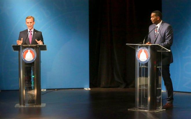 4th Congressional District Republican candidate Burgess Owens, right and Democratic Utah Congressman Ben McAdams debate on Monday, Oct. 12, 2020, in Salt Lake City. (Kristin Murphy/ Deseret News, via AP, Pool)