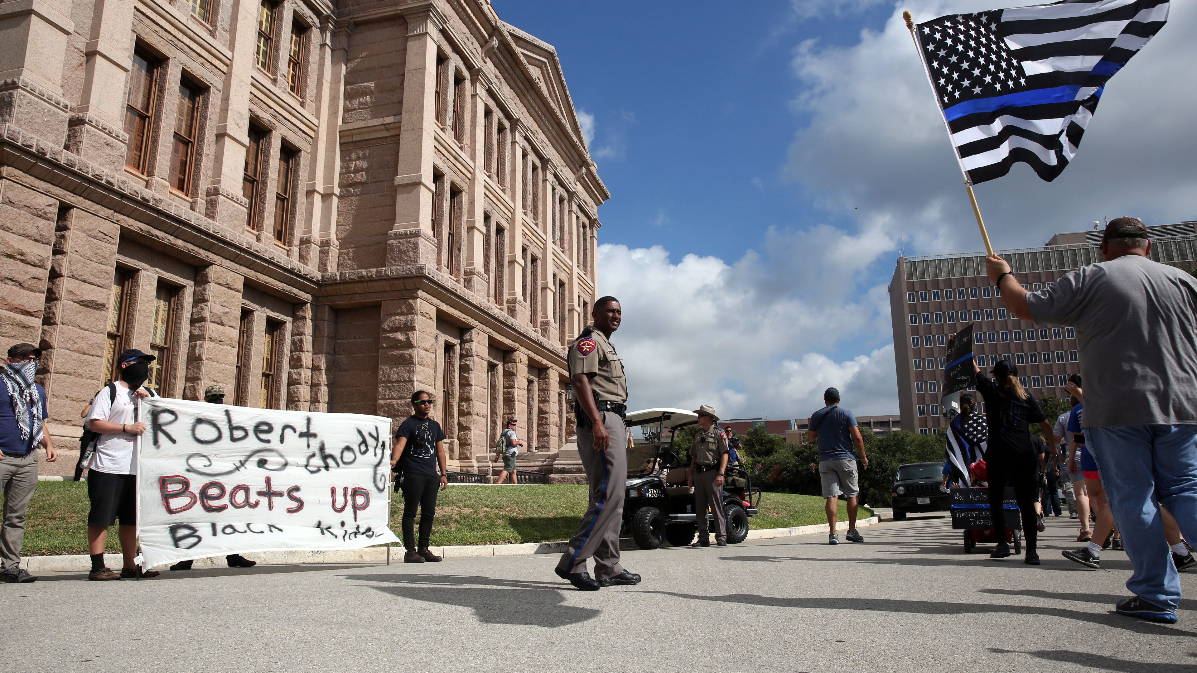 On the morning of Sept. 19, 2015, Texas Department of Public Safety trooper McPherson (who declined to give his first name) kept a watchful eye over separate Black Lives Matter and Police Lives Matter rallies that converged at the State Capitol building in Austin, TX.