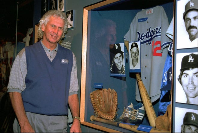 Former Los Angeles Dodgers pitcher Don Sutton stands next to a Dodgers exhibit at the Baseball Hall of Fame in Cooperstown, N.Y., two months before his induction in 1998.