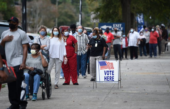 Oct. 12 was the first day for advance voting in Georgia, and people showed up by the hundreds to cast their ballot early at the Bell Auditorium in Augusta.
