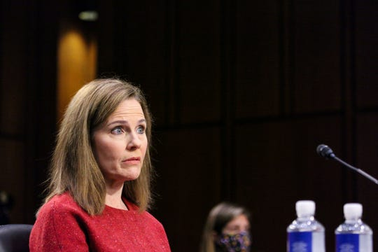 Supreme Court nominee Amy Coney Barrett listens during a confirmation hearing before the Senate Judiciary Committee on Tuesday.