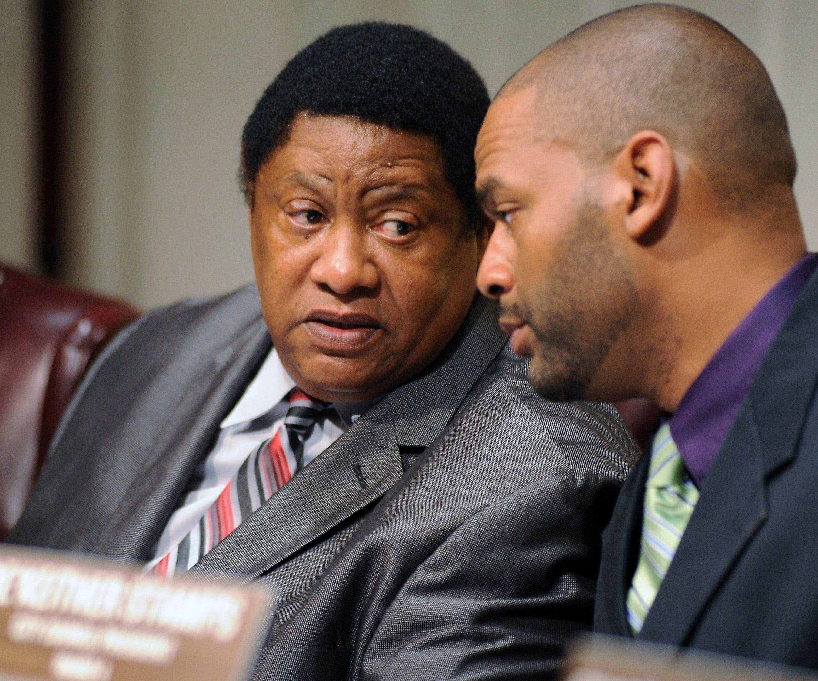 Jackson, Mississippi, City Councilman Kenneth Stokes, left, talks with council president De'Keither Stamps before a Jackson City Council meeting  in February 2015.