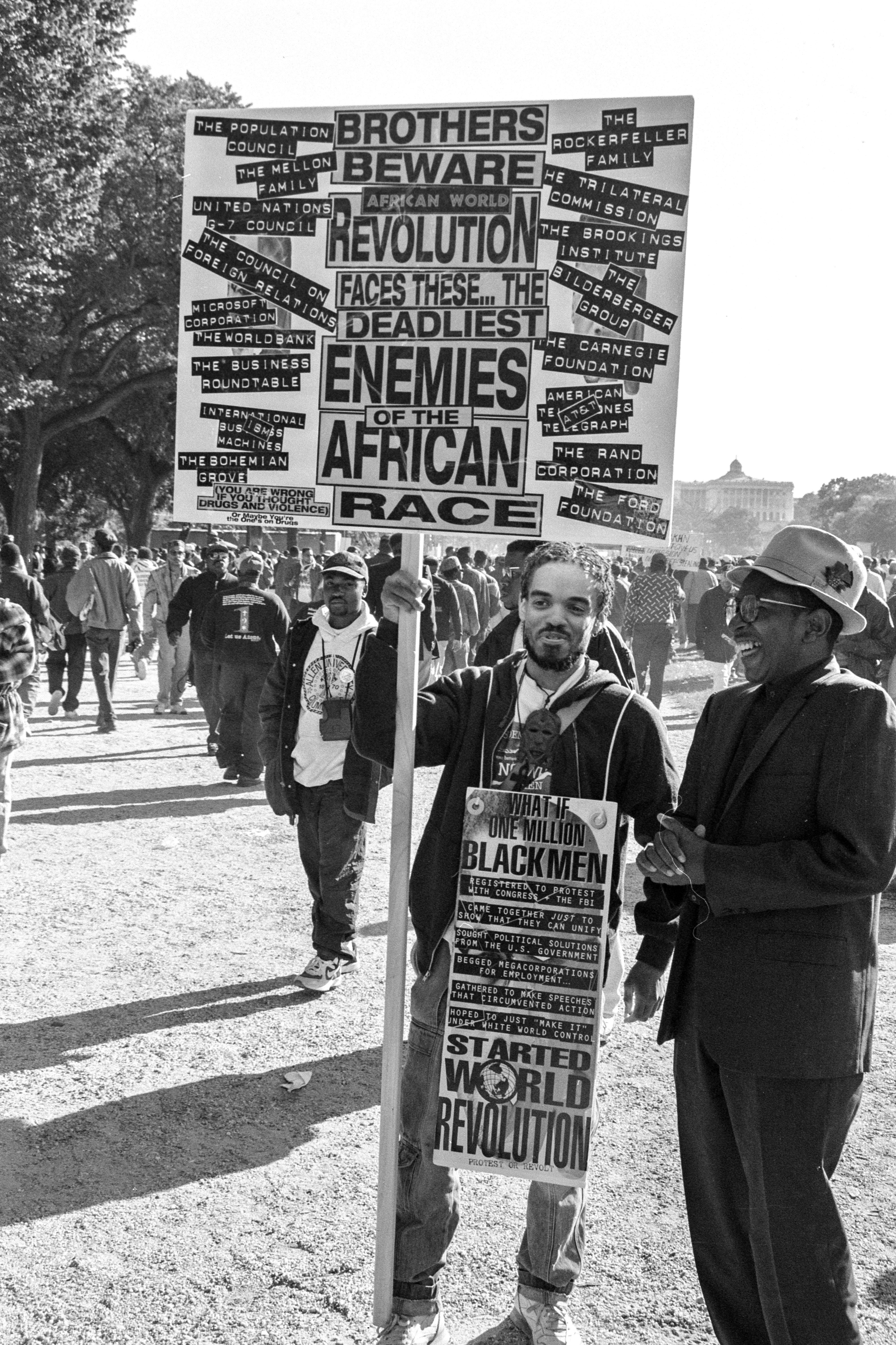 The Million Man March of 1995 carried a multitude of message and missions, some of them reflected in a handmade sign displayed by one of the participants.