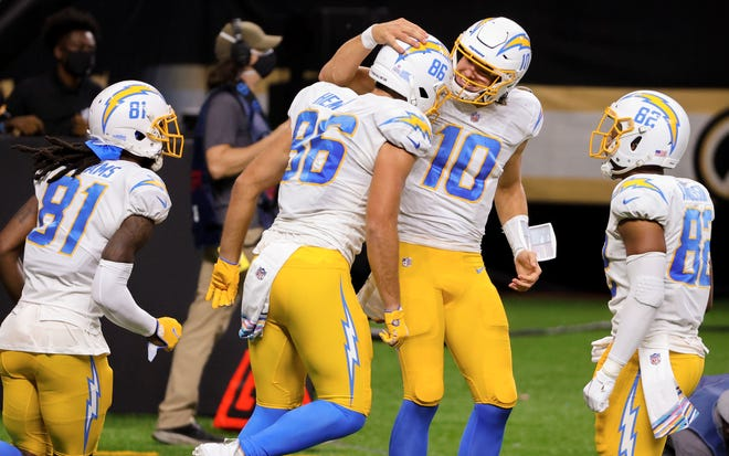Los Angeles Chargers quarterback Justin Herbert (10), here celebrating a touchdown with tight end Hunter Henry, will try to pick up his first win as an NFL starter against Jacksonville on Sunday.
