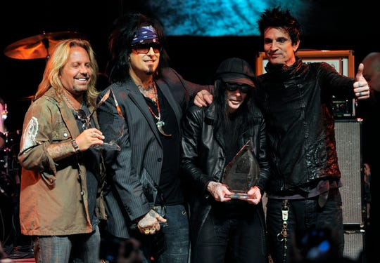 Mötley Crüe members Vince Neal, left, Nikki Six, Mick Mars and Tommy Lee on stage in West Hollywood, California, in 2011.