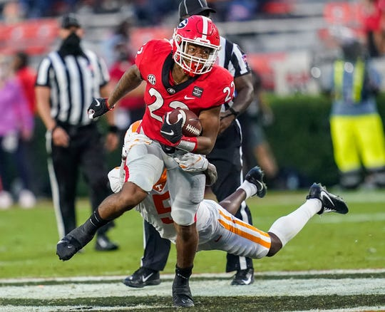 Georgia running back Kendall Milton (22) run s with the ball against Tennessee during the second half at Sanford Stadium.
