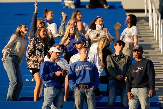Kentucky fans cheer mostly without masks during the second half of a college football game against Mississippi on Oct. 13 in Lexington, Ky.