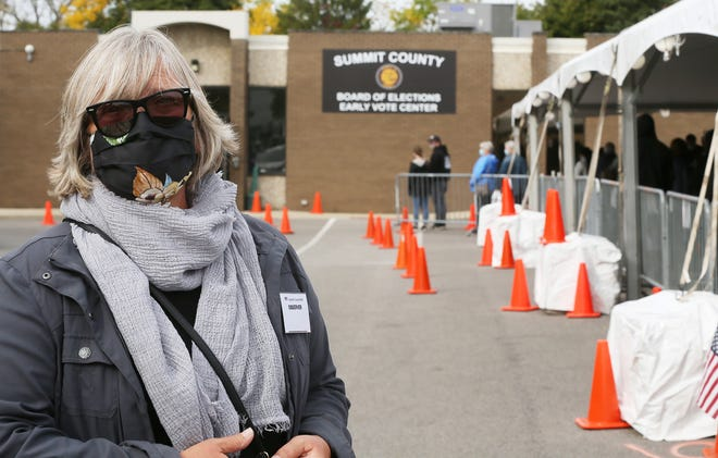 Civil rights attorney Nancy Holland, a poll observer, talks about being an observer at the Summit County early voting site at 500 Grant St. on Oct. 14, 2020, in Akron. Holland has been selected to fill the Ward 1 council vacancy.