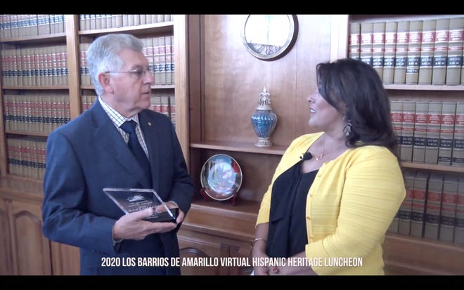 Mary Bralley (right) gives the 2020 Hispanic Man of the Year award to Daniel Martinez during Wednesday's virtual Hispanic Heritage Month Luncheon.