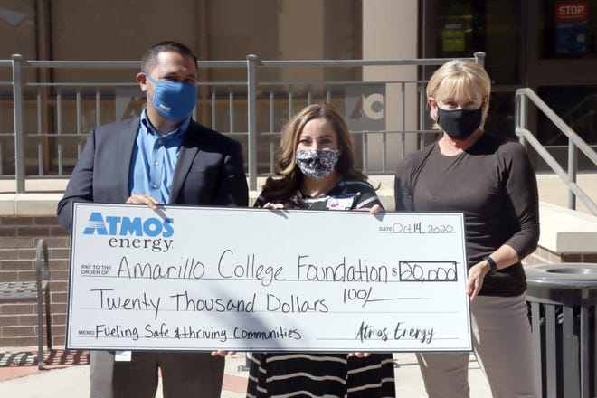 Michael Gonzales, the public affairs manager for Atmos Energy, presents a $20,000 check to the Amarillo College Foundation, represented by Jordan Herrera, the college's director of social services, and Tracy Dougherty with the foundation. The funds are administered by the foundation and will be distributed through the college's advocacy and resource center  [Neil Starkey / For the Amarillo Globe-News]