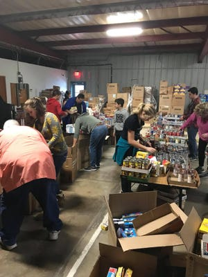 Volunteers sort through items at the Food and Resource Center of South Central Oklahoma.