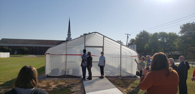 A Take Two student is jointed by Ardmore City Schools Superintendent Kim Holland and Director Lori Bell at the ribbon cutting of the Gresham Garden on Wednesday. The students will grow and then sell fruits and vegetables, therefore teaching them about both horticulture and entrepreneurship.
