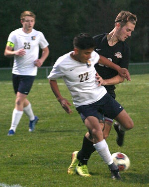 Ashland's Alex Lane (20) and Norwalk's Jose Excobedo (22) battle for the ball during soccer action Tuesday at Community Soccer Stadium. The Arrows won, 5-0