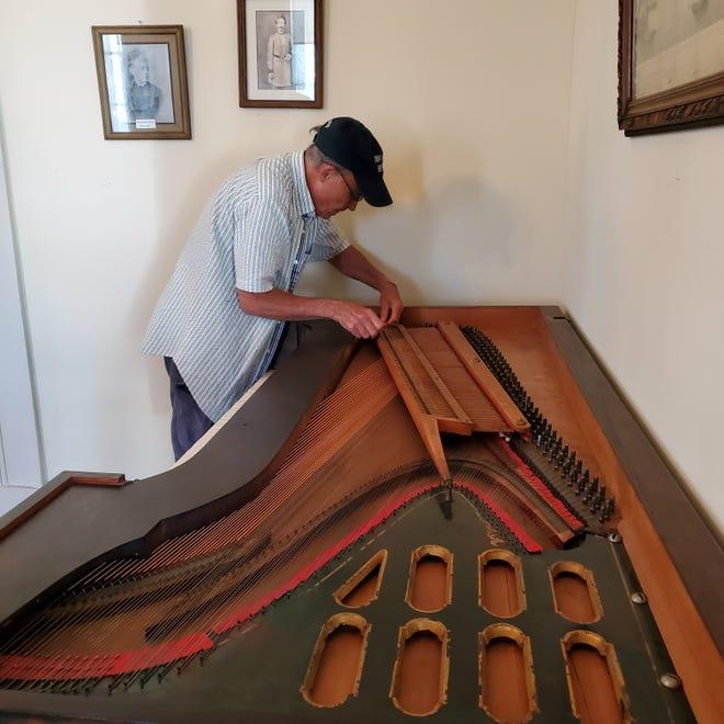 Bill Gladwin setting up the piano.