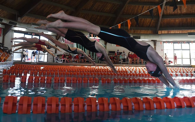 Ames' Gracie Wesselmann, Alex Harswick, and Meghan Donald dive in the pool during a 50-yard freestyle in a dual meet against Mason City at Ames High Pool Tuesday, Oct. 13, 2020.