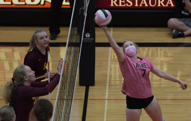 Ames' Rachel Rosaker returns the ball over Ankeny's Ava Reynolds and Aowyn Schrader during the second set of the Little Cyclones' loss to the No. 2 Hawks at the Ames High gym Tuesday. Ames fell short in three sets, but finished the match strong.