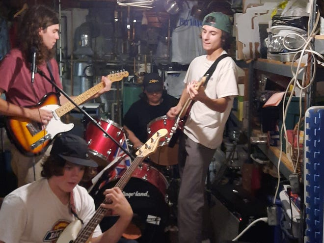Local rock band The Convinced practice before an upcoming show. Members are Vince Tucci, Mike Deren, Nick Swartz and Max Zebertavage.