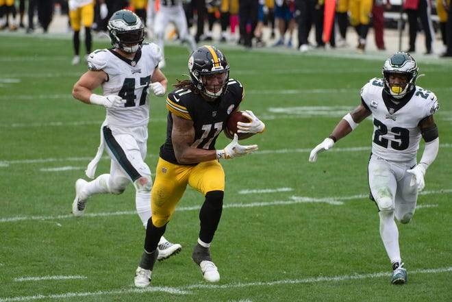 Eagles linebacker Nate Gerry, 47, and safety Rodney McLeod chase Steelers receiver Chase Claypool, who scored his fourth touchdown on the fourth-quarter play Sunday.