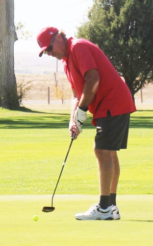 Bob Malden putts on the ninth green at the La Junta Seniors Golf League tournament on Oct. 13.