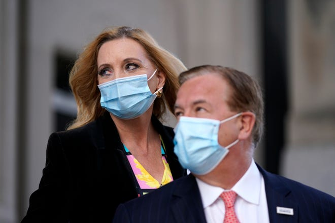 Mark and Patricia McCloskey leave following a court hearing on Oct. 14 in St. Louis.