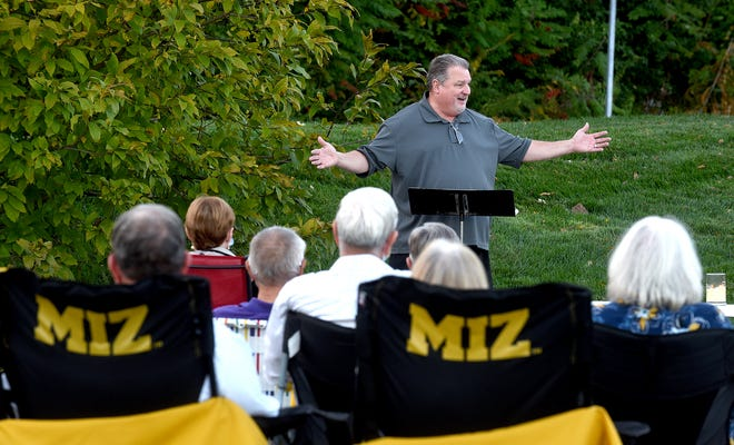 Missouri United Methodist Church Rev. Fred Leist holds tailgate vespers services outdoors in the parking lot. [Don Shrubshell/Tribune]